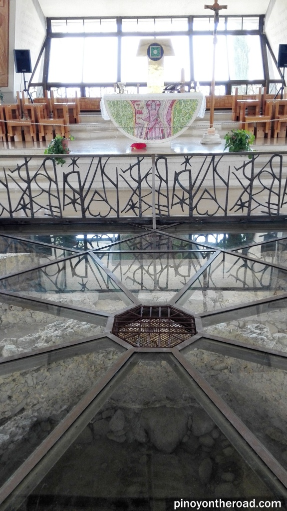 Altar of the Church of Peter with a glass floor where one can see the ruins of the octagonal Byzantine Church and on the center is the ruins of Peter's House