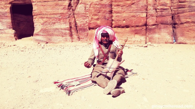 A Bedouin playing am indigenous musical instrument