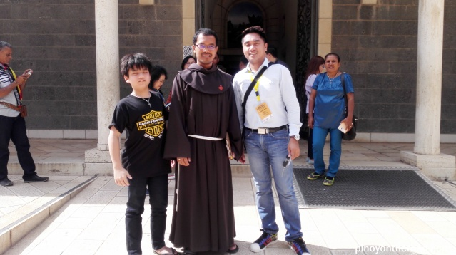 Posing for a souvenir picture of the Malaysian Priest who officiated the mass